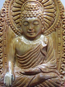 Close up of Buddha in the same carving