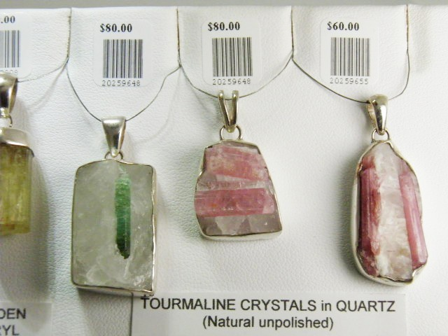 Tourmaline crystals in quartz. Hand in sterling silver pendants