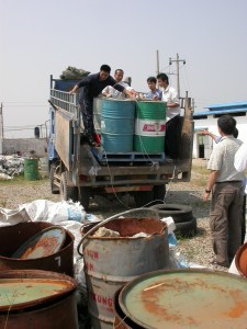 Drums of our gem rough being delivered to China factory
