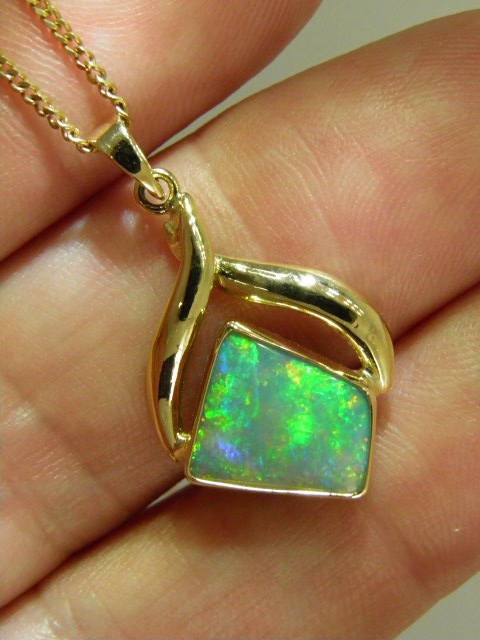 Flashy OPAL SOLID 18 ct gold pendant (A$2500)
