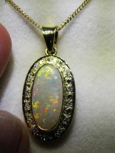 OPAL SOLID (19x9mm) With DIAMONDS 18 carat gold Code 20182182 A$4000