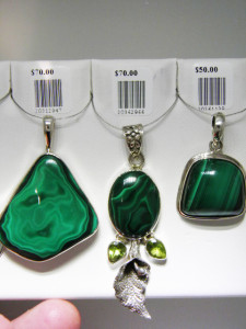 MALACHITE Set in sterling silver Three of many pendants