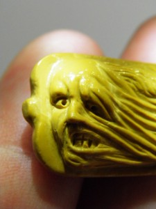 One face of the carving