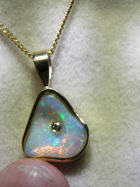 CRYSTAL OPAL (14mm by 14mm) 14 carats gold Code 20382971 A$1800